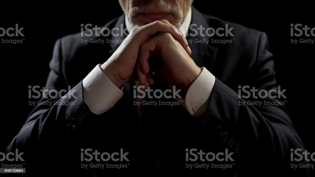 Businessman leaning on elbows, professional lawyer listening patiently to client stock photo