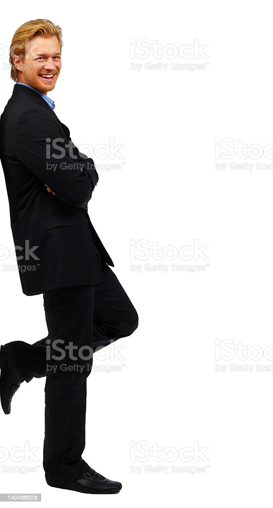 Businessman leaning on wall royalty-free stock photo