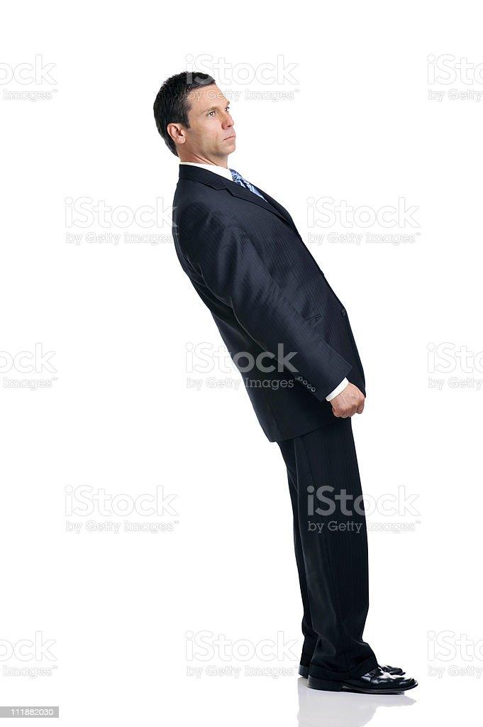 Businessman Leaning Over Backwards Isolated on White Background stock photo
