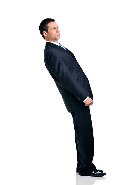 Businessman Leaning Over Backwards Isolated on White Background Businessman leaning impossibly over backwards, isolated Isolated on White Background bending over backwards stock pictures, royalty-free photos & images