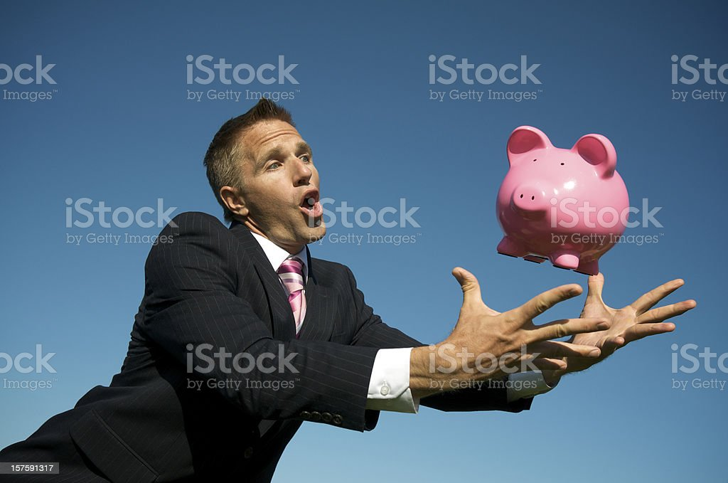Businessman Leaps for Pink Piggy Bank royalty-free stock photo