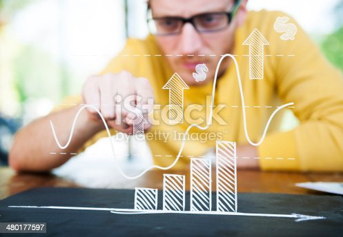 istock Businessman Learning the Graph with a Serious Face 480177597