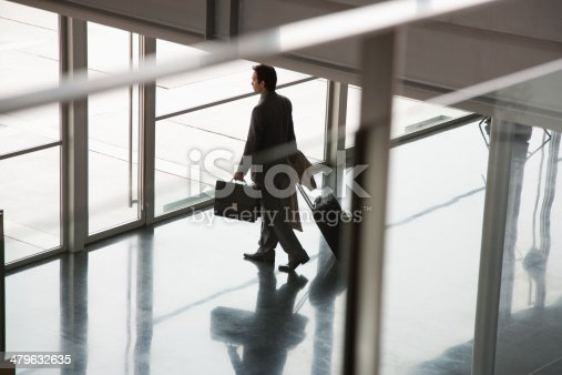 istock Businessman leaving building with suitcase 479632635