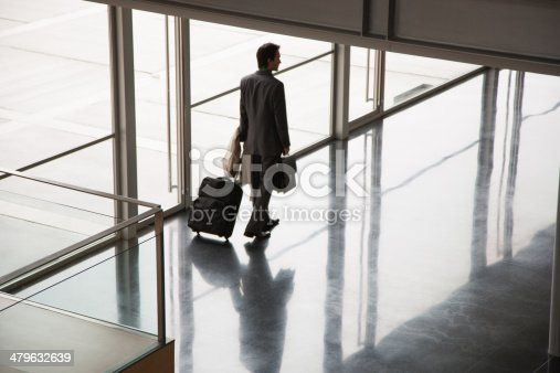 istock Businessman leaving building with suitcase 479632639