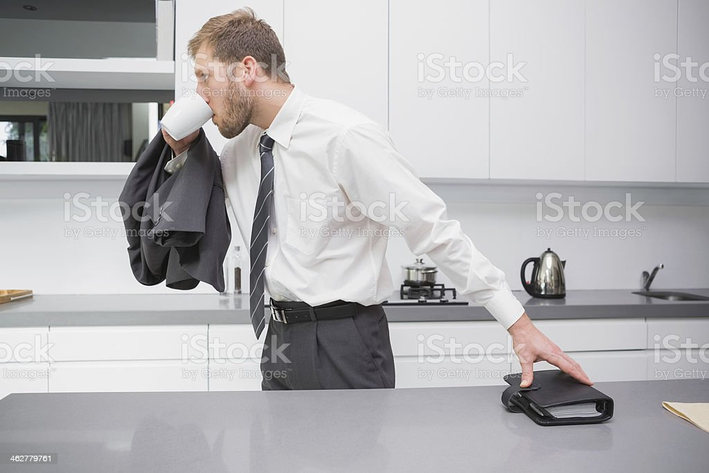 Businessman leaving for work stock photo