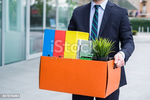 1181817161 istock photo Businessman leaving his office after termination of employment 947976484