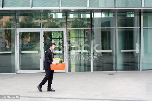 1181817161 istock photo Businessman leaving his office after termination of employment 947976716