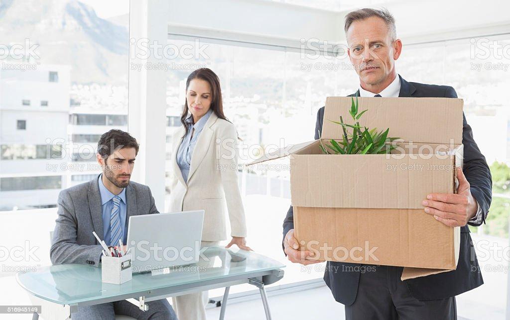 Businessman leaving his old job stock photo