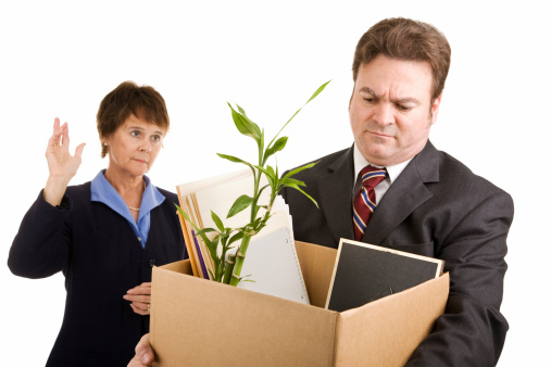 A Businessman Leaving Work With A Box Full Of His Desk Stuff Stock Photo - Download Image Now