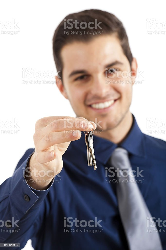 Businessman lending his keys royalty-free stock photo
