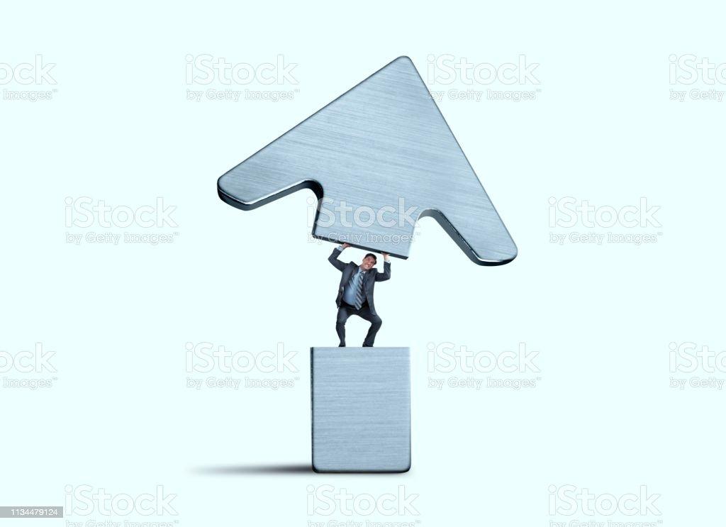 Businessman Lifting Other Half Of Arrow stock photo