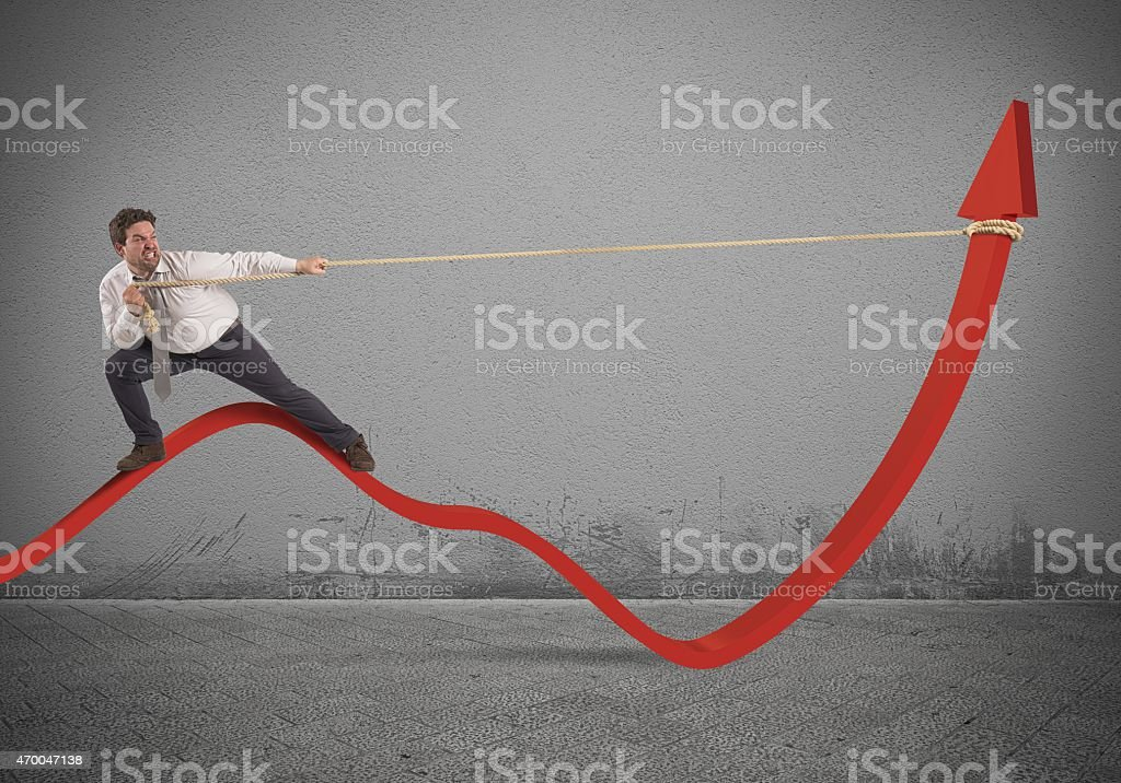 Businessman lifts statistics Determinated businessman with much effort lifts statistics 2015 Stock Photo