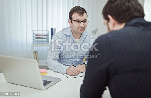 istock Businessman listen to job candidate 675436264