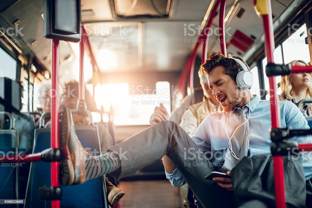 Businessman listening to music stock photo