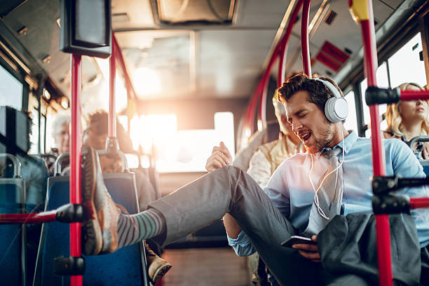 businessman listening to music - defiance stock pictures, royalty-free photos & images