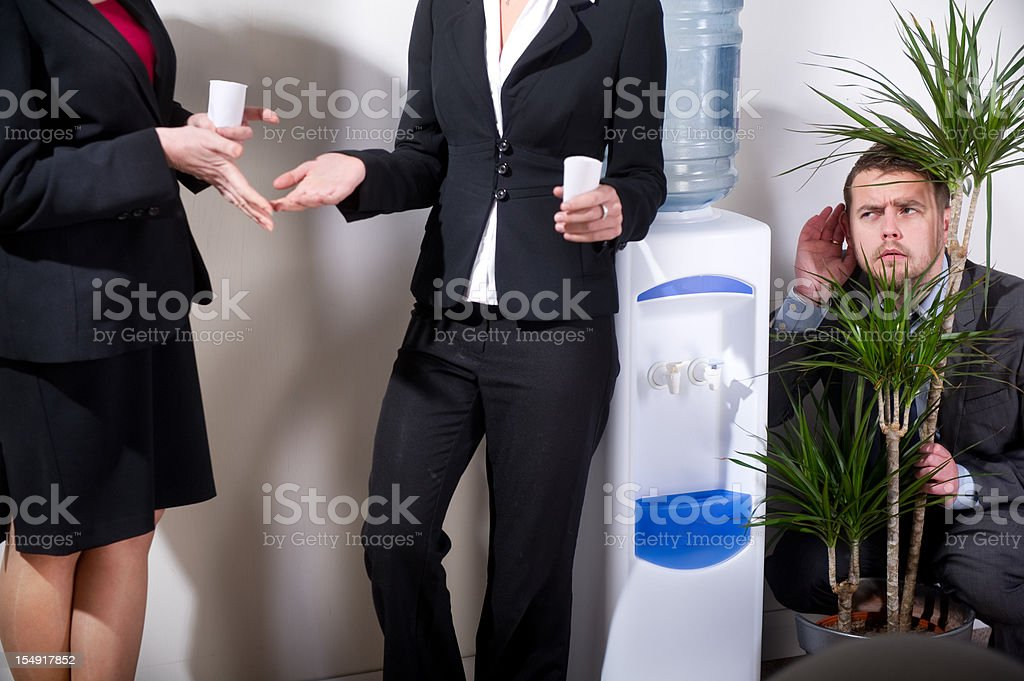 businessman listens in to office gossip stock photo