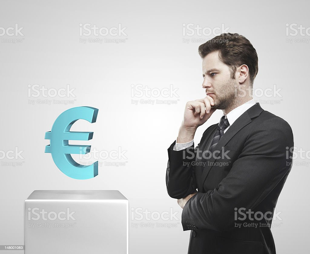 Businessman look at the blue Euro sign on a pedestal royalty-free stock photo