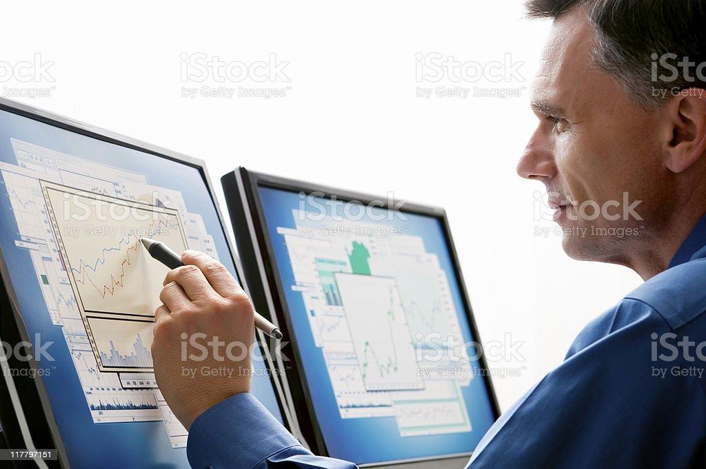 Businessman Looking a Computer Monitors  401k Stock Photo