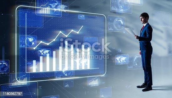 istock Businessman looking at a chart. Financial planner. FIntech. 1180562797