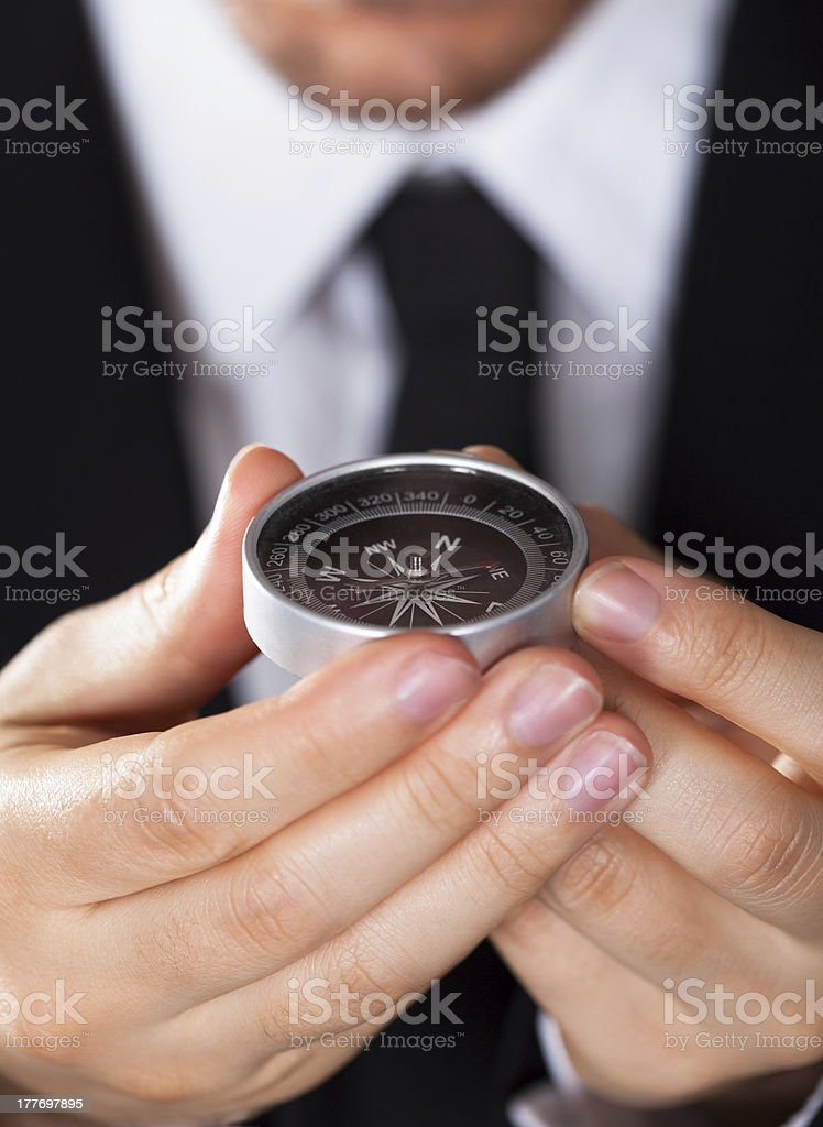 Businessman looking at a compass stock photo