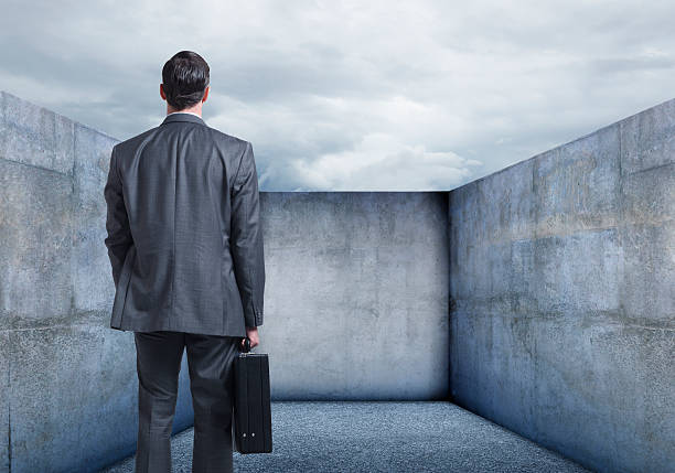 businessman looking at a dead end - trapped stock pictures, royalty-free photos & images