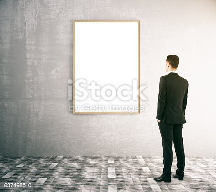 istock Businessman looking at blank frame 637498510
