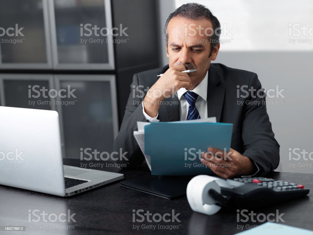 Businessman looking at document royalty-free stock photo