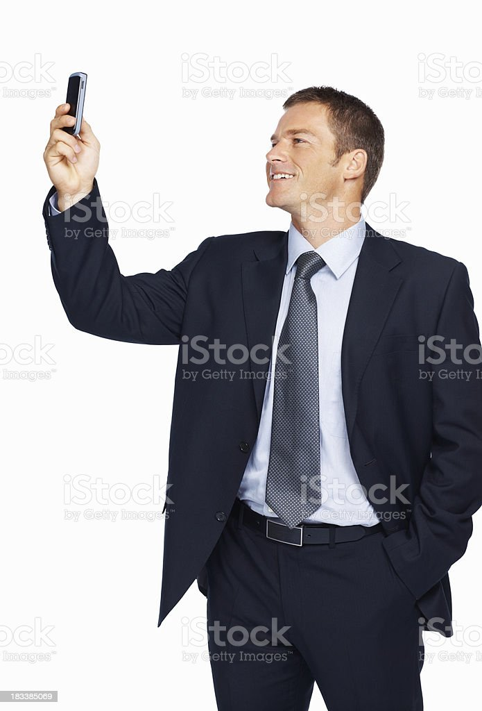 Businessman looking at his cell phone stock photo
