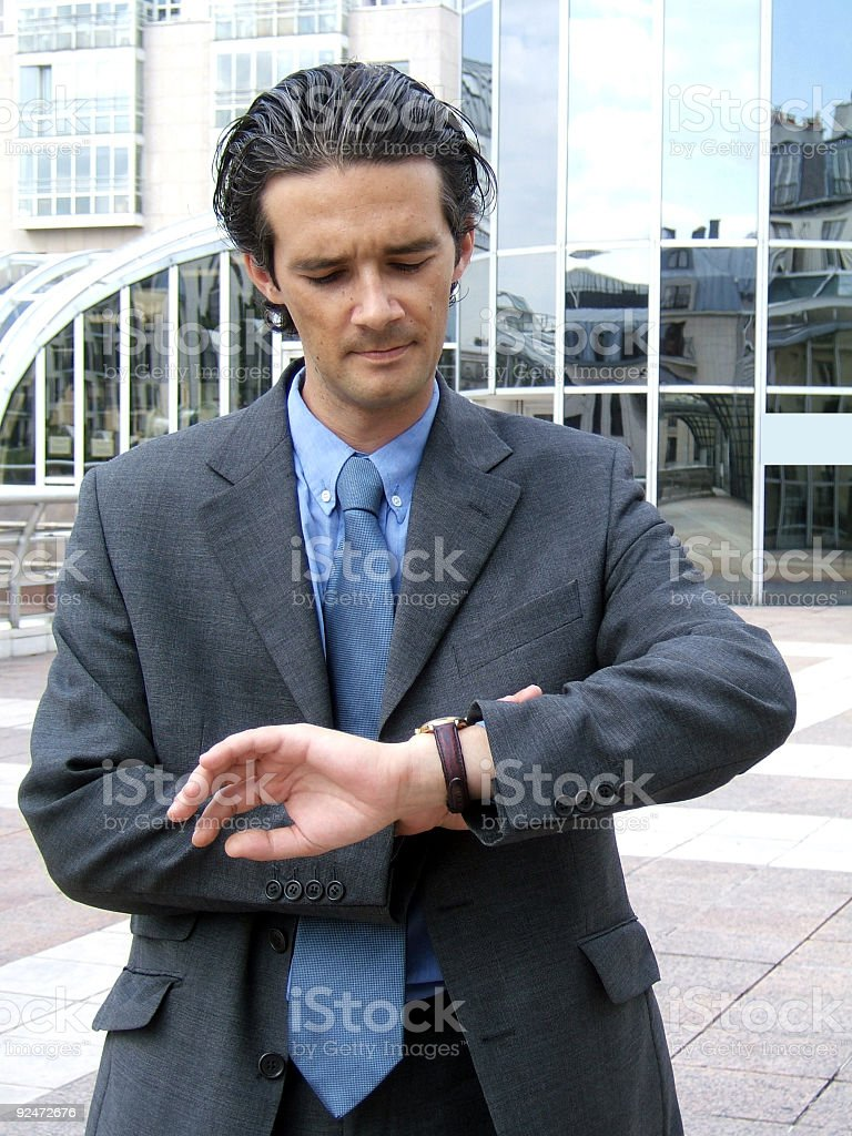 Businessman looking at his watch royalty-free stock photo