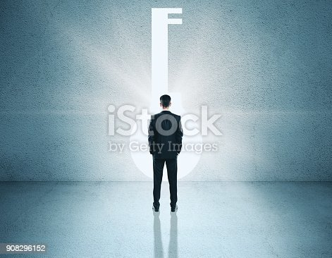 istock Businessman looking at key opening 908296152