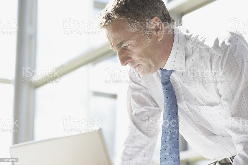 Businessman looking at laptop royalty-free stock photo