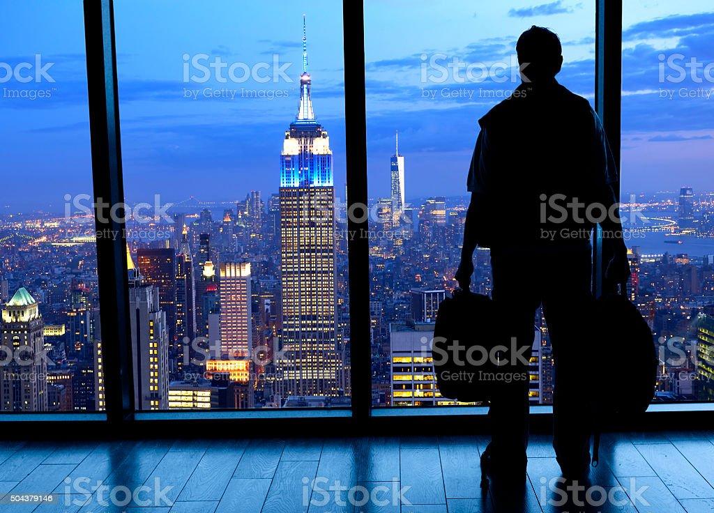 Businessman looking at Manhattan skyline. stock photo