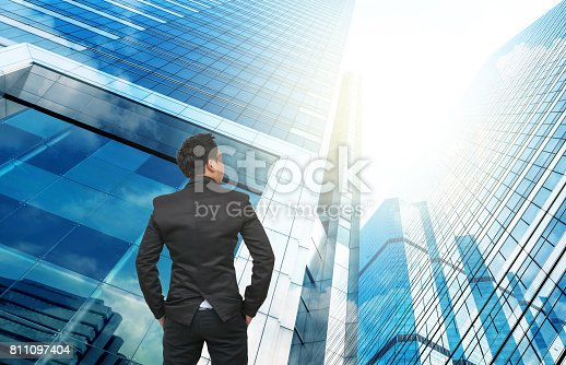 istock Businessman looking at office buildings, Business career concept 811097404