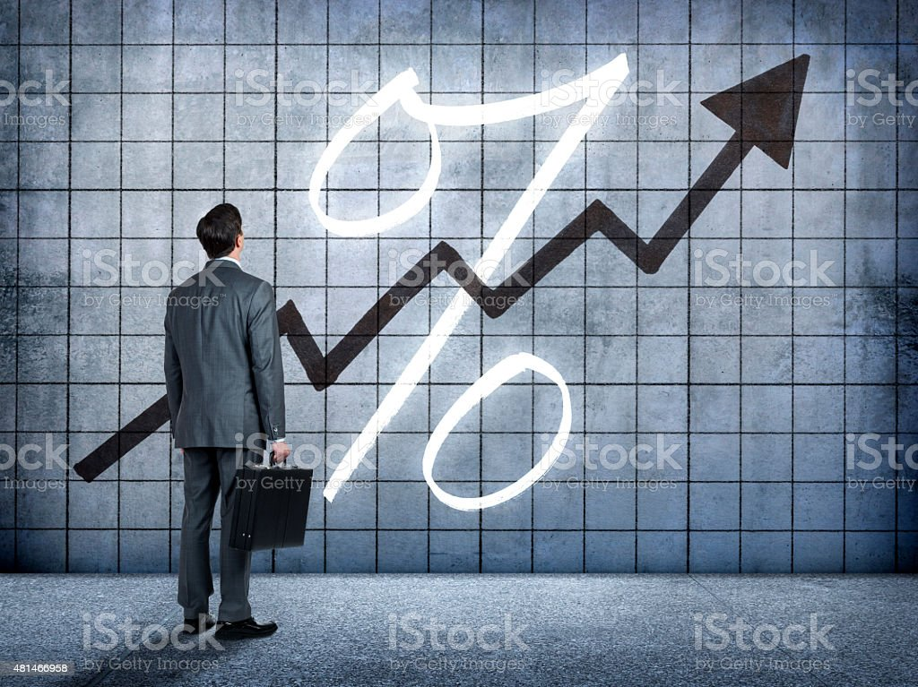 Businessman Looking At Prospect Of Higher Interest Rates stock photo