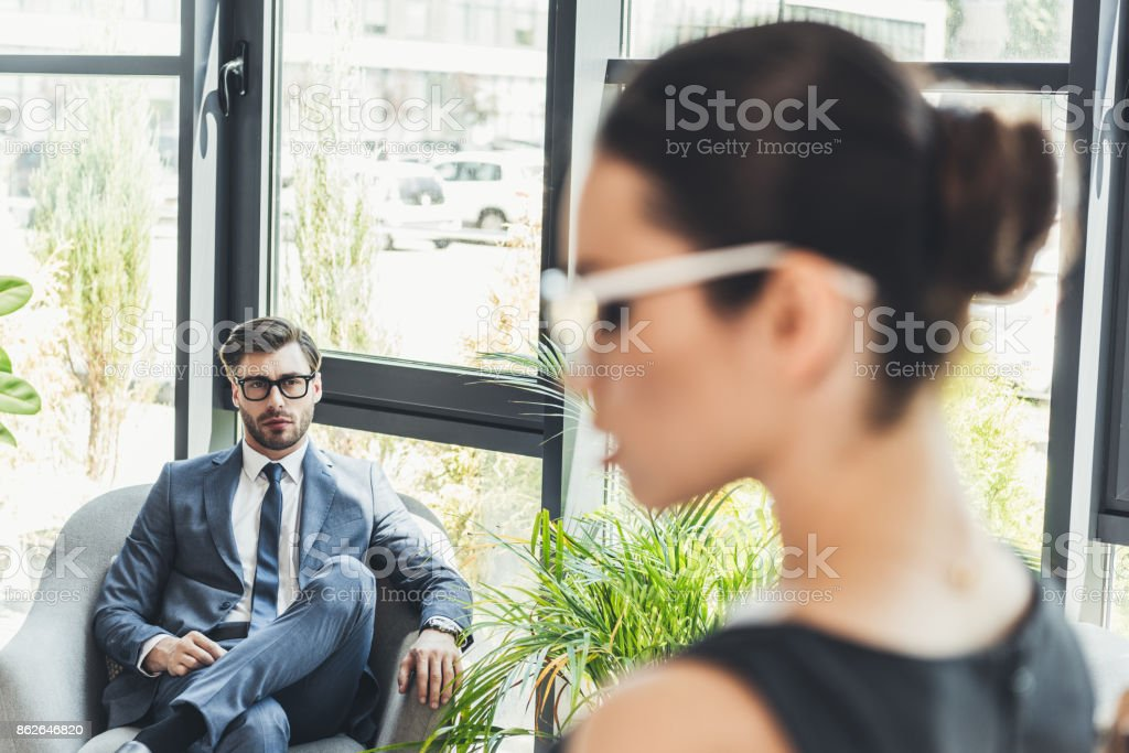 businessman looking at secretery stock photo