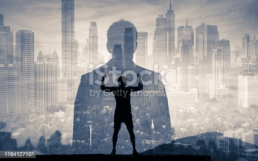 994786356 istock photo Businessman looking at the city 1154127101