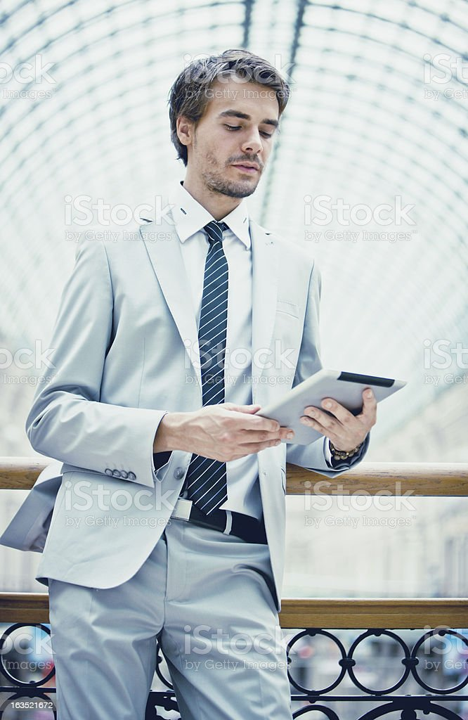 Businessman Looking at the Digital Tablet Screen royalty-free stock photo
