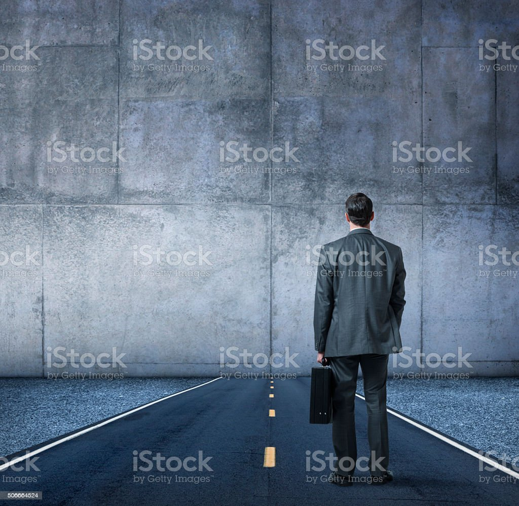 Businessman Looking At The End Of The Road stock photo