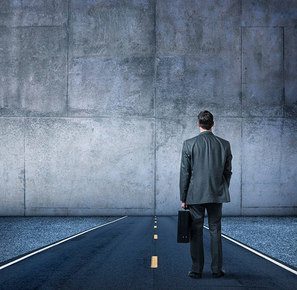 businessman looking at the end of the road - trapped stock pictures, royalty-free photos & images