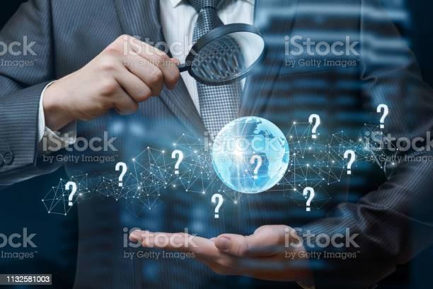 Businessman looking at the globe through the magnifier picture id1132581003?b=1&k=6&m=1132581003&s=612x612&h=v0ysnvpsmqqftyr3hg6mm5nmug imu4g1shsmqqsap4=