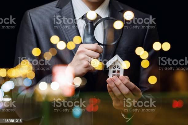 Businessman looking at the house model through the magnifier picture id1132581016?b=1&k=6&m=1132581016&s=612x612&h=q6uc4h0npraoeni4 q3mzrqxmw1looxxw3gjkooe3ha=