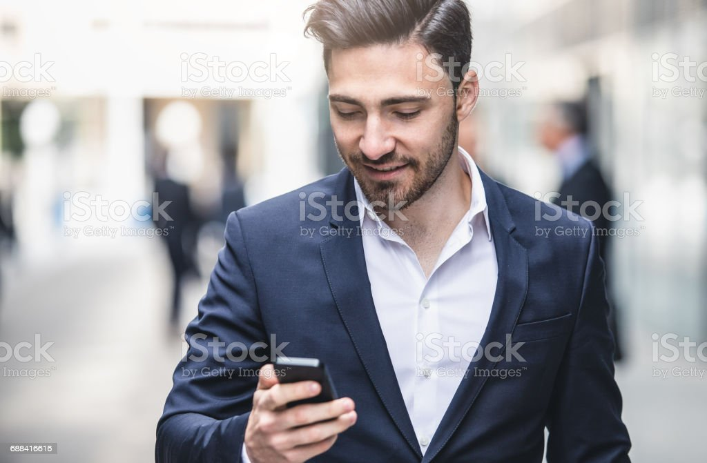 Businessman Looking at the Mobile Phone stock photo