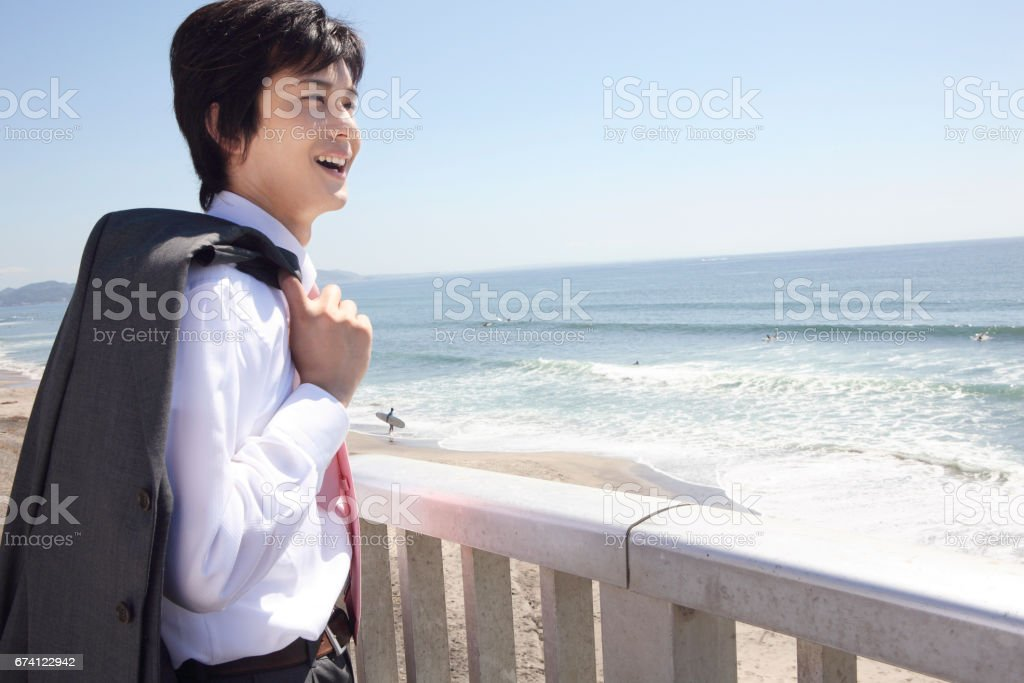 Businessman looking at the sea royalty-free stock photo