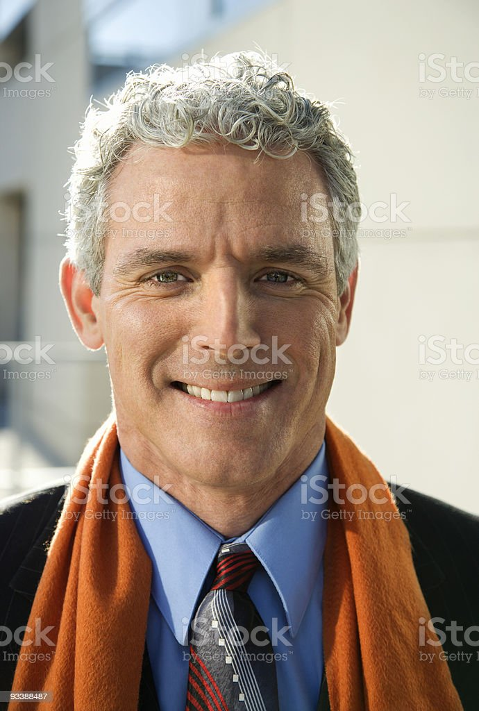 Businessman looking at viewer smiling. royalty-free stock photo