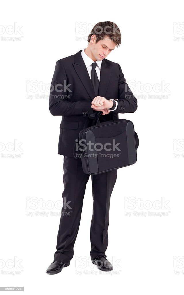 businessman looking at wrist watch royalty-free stock photo