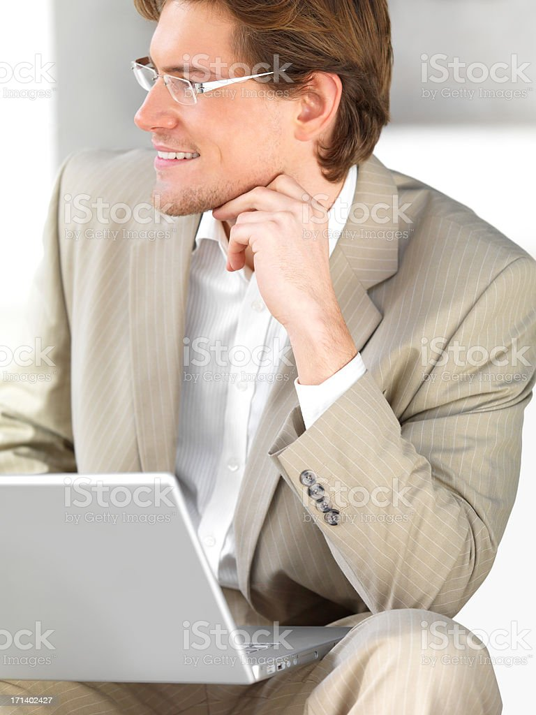 Businessman looking away and working on laptop royalty-free stock photo