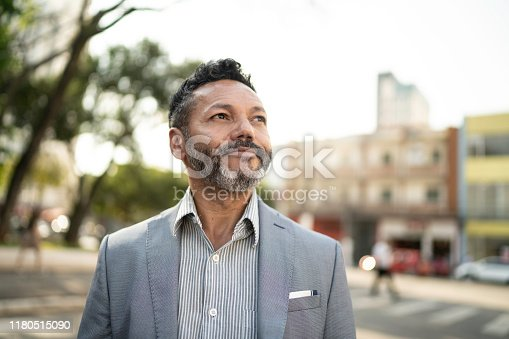 Businessman looking away on the street