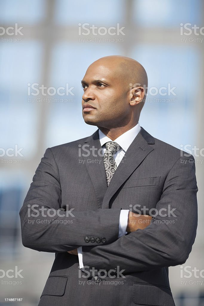 Businessman Looking Away With Arms Crossed royalty-free stock photo