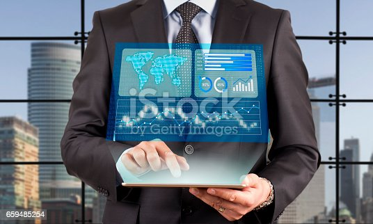 istock Businessman looking financial graphics on tablet computer 659485254