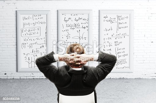istock businessman looking formulas on desk 503489038